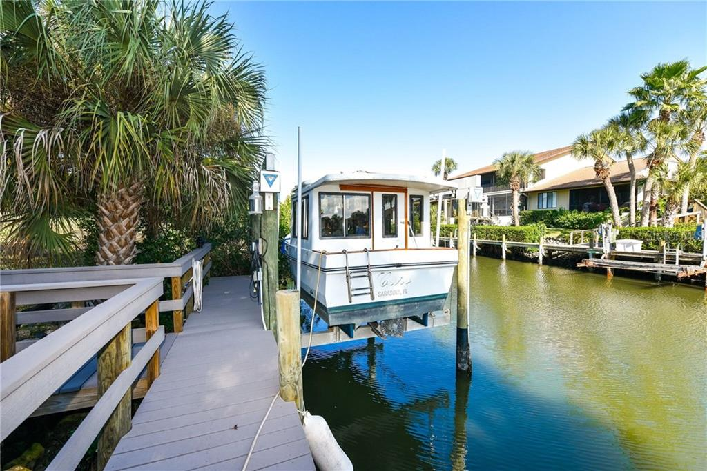 Previously furnished living room - Single Family Home for sale at 6701 Avenue B, Sarasota, FL 34231 - MLS Number is A4171657