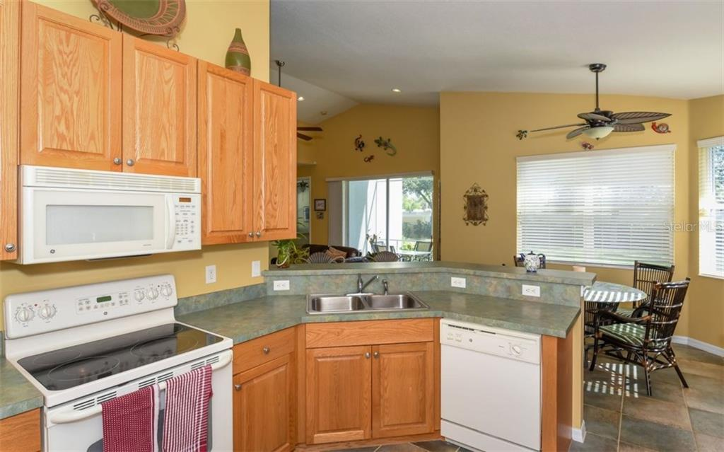 Kitchen/Dinette - Single Family Home for sale at 6531 38th Ln E, Sarasota, FL 34243 - MLS Number is A4174191