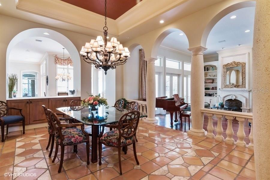 Dining Room with built in Buffets, ideal for entertaining. Comfortable for large or small gatherings alike. - Single Family Home for sale at 8130 Perry Maxwell Cir, Sarasota, FL 34240 - MLS Number is A4175735