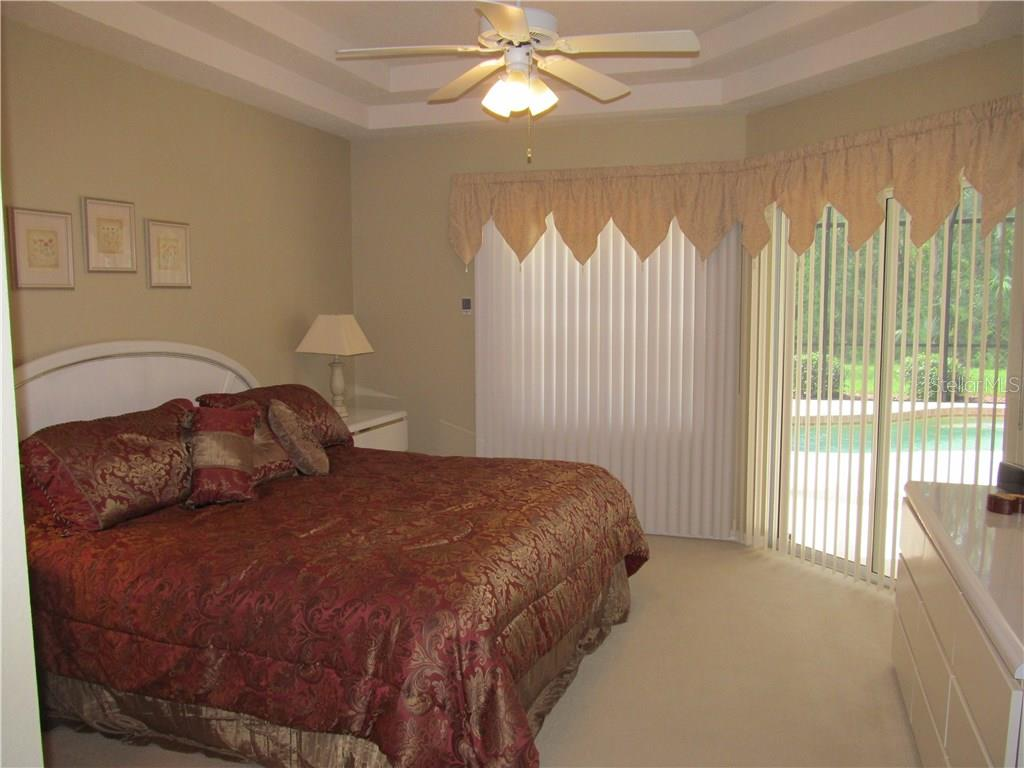 SPACIOUS MASTER BEDROOM WITH DOUBLE TRAY CEILING OVERLOOKING THE POOL - Single Family Home for sale at 7007 Chickasaw Bayou Rd, Bradenton, FL 34203 - MLS Number is A4177136