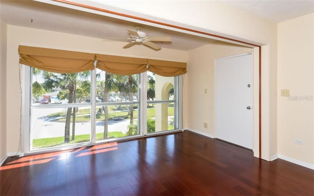 Living room with wood flooring - Condo for sale at 133 Avenida Messina #4, Sarasota, FL 34242 - MLS Number is A4179566