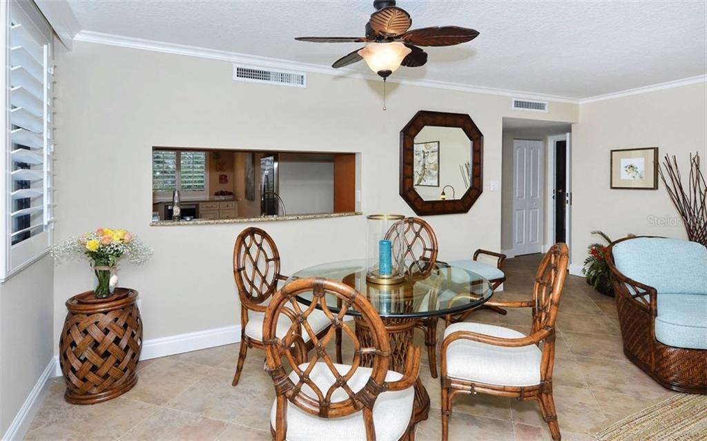 Dining area - Condo for sale at 6263 Midnight Pass Rd #101, Sarasota, FL 34242 - MLS Number is A4182245