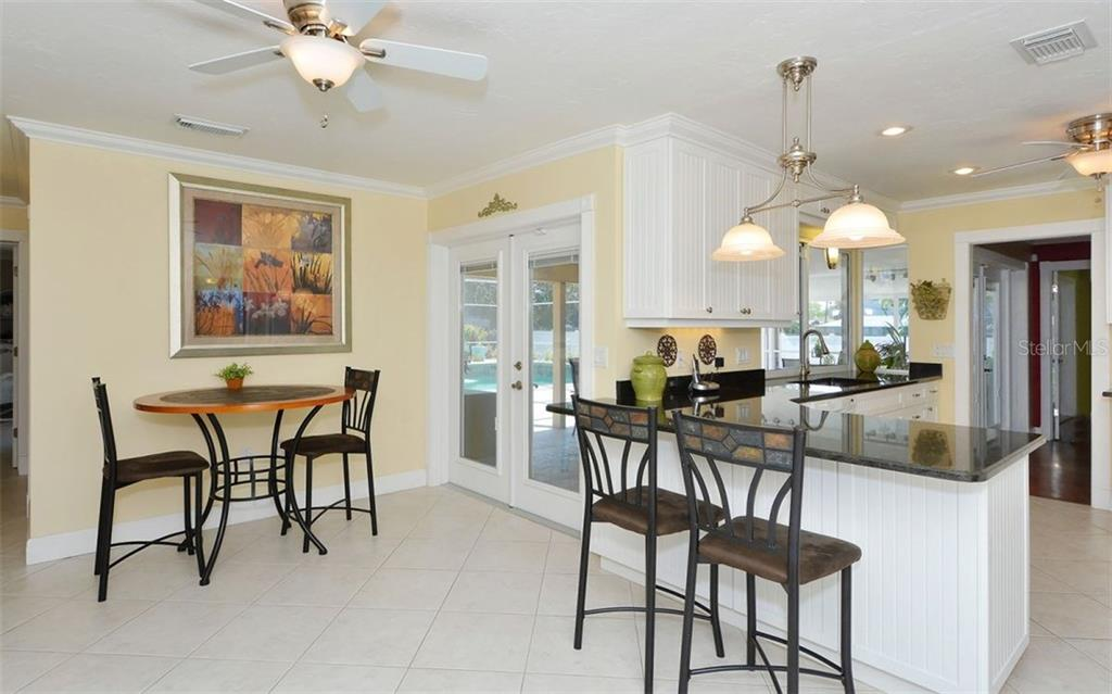 Kitchen opens to breakfast room or use as a family room. - Single Family Home for sale at 6239 Hollywood Blvd, Sarasota, FL 34231 - MLS Number is A4182790