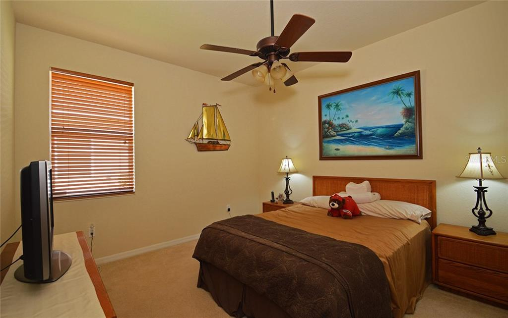 Guest Bedroom Two - Single Family Home for sale at 9006 Heritage Sound Dr, Bradenton, FL 34212 - MLS Number is A4183771