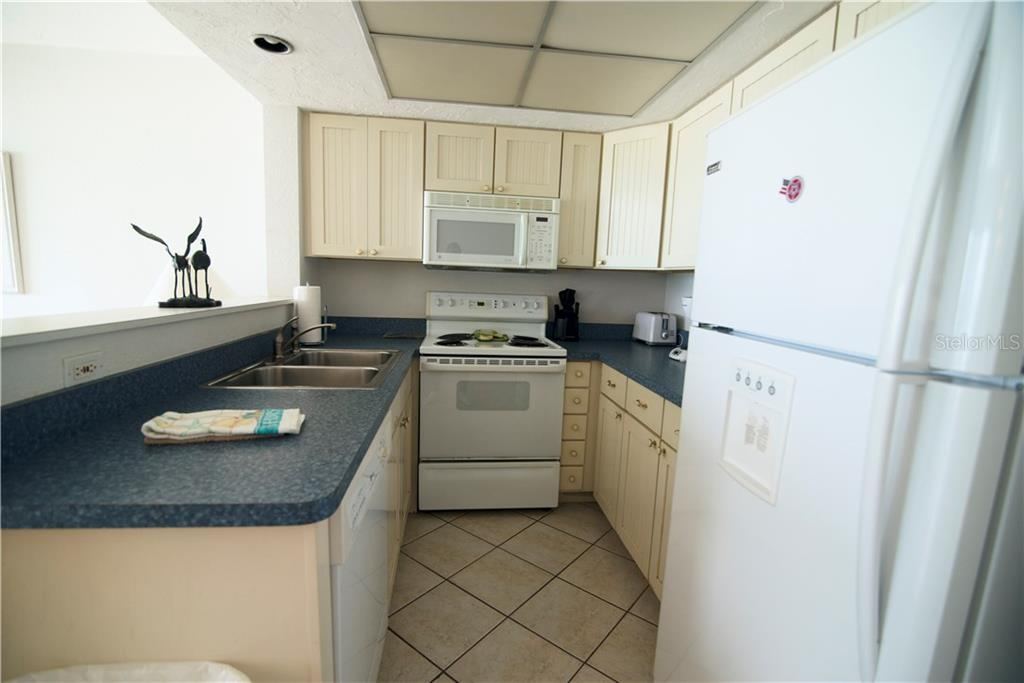 Kitchen - Condo for sale at 100 73rd St #202a, Holmes Beach, FL 34217 - MLS Number is A4184505