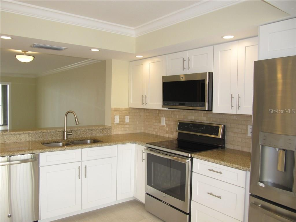 New Kitchen - Condo for sale at 6440 Mourning Dove Dr #404, Bradenton, FL 34210 - MLS Number is A4185069