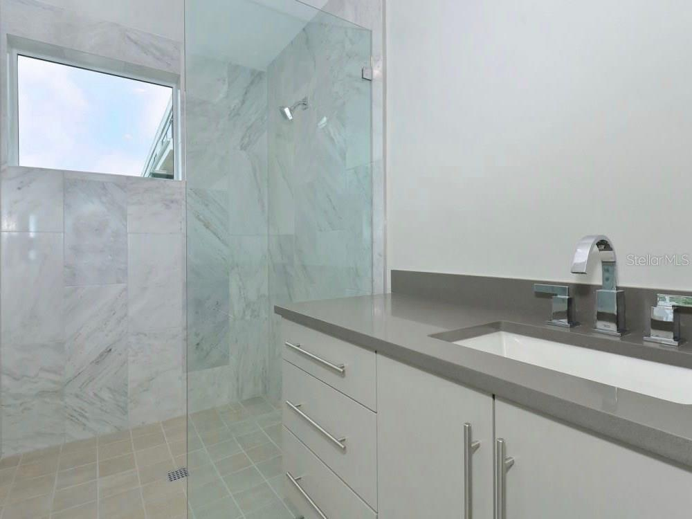 Bathroom - Single Family Home for sale at 641 Beach Rd, Sarasota, FL 34242 - MLS Number is A4185328
