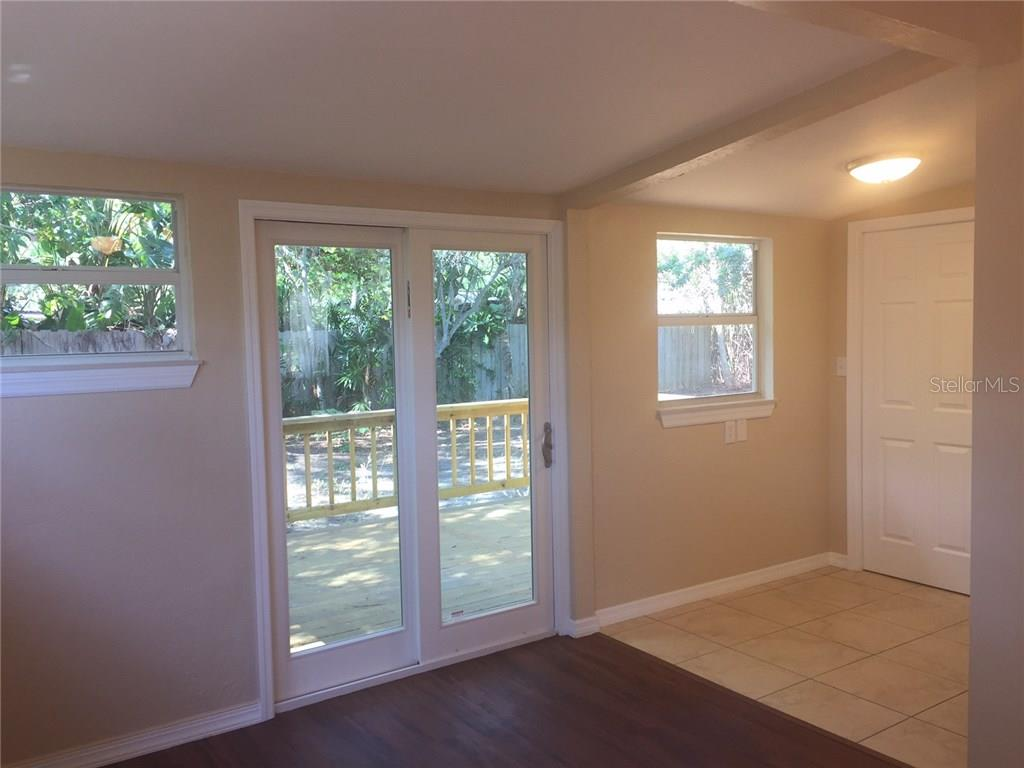 Sliding door to the wooden deck and the breakfast nook. - Single Family Home for sale at 938 Highland St, Sarasota, FL 34234 - MLS Number is A4186423