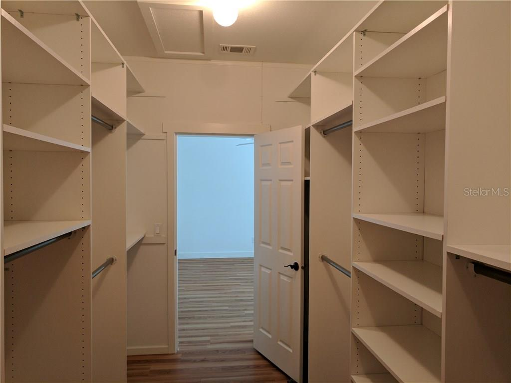 SPACIOUS MASTER BEDROOM CLOSET - Single Family Home for sale at 591 Cedar St, Longboat Key, FL 34228 - MLS Number is A4187813