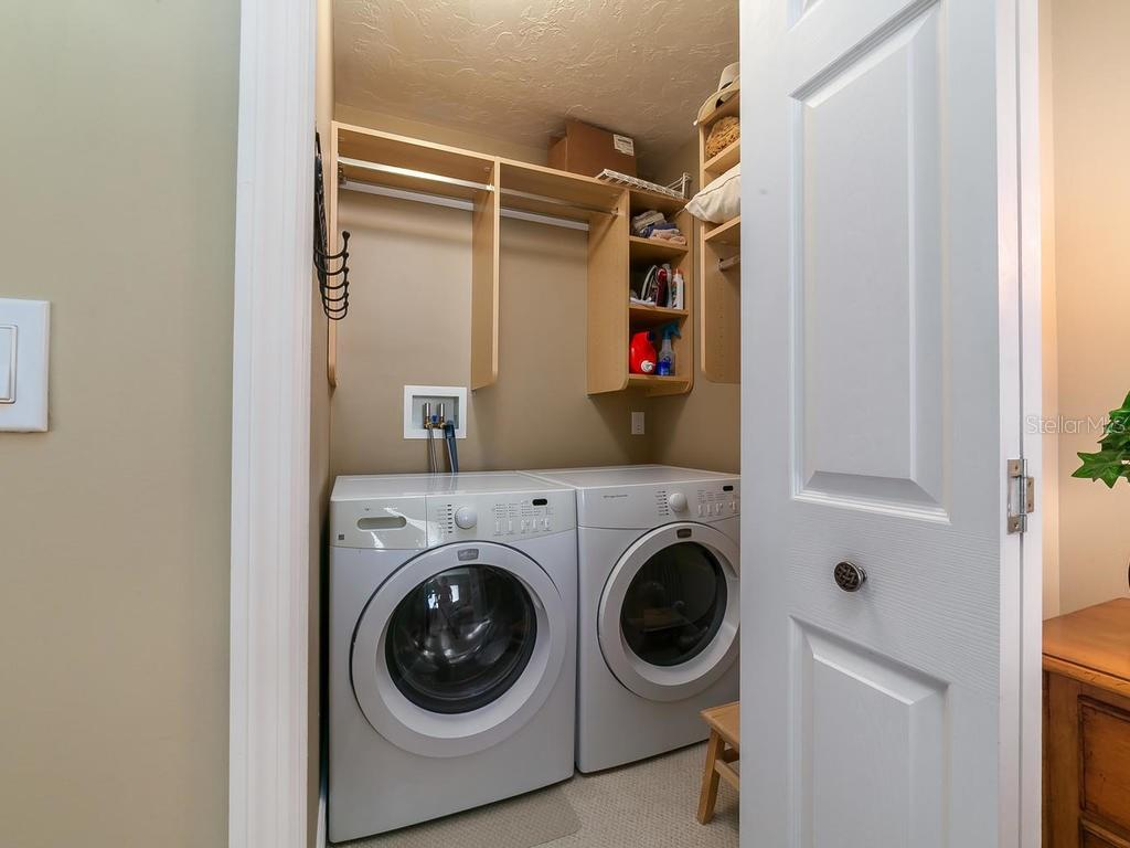 In residence laundry room - Condo for sale at 6236 Midnight Pass Rd #406, Sarasota, FL 34242 - MLS Number is A4188093
