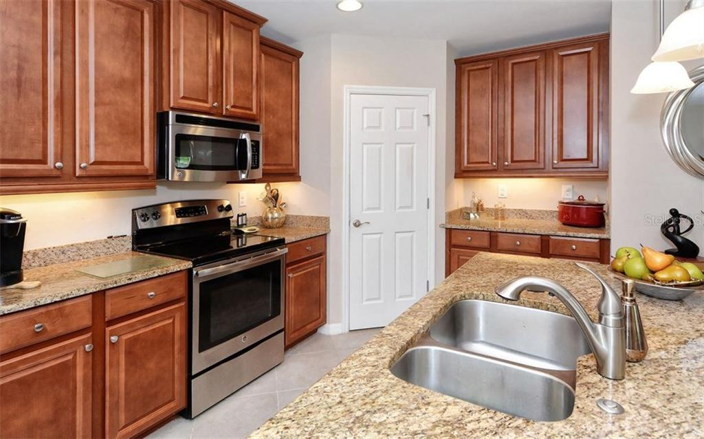 Kitchen - Condo for sale at 81 Navigation Cir #103, Osprey, FL 34229 - MLS Number is A4188370