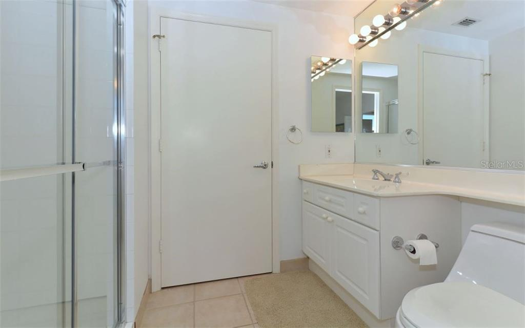 Second bedroom with access to balcony overlooking Sarasota Bay - Condo for sale at 1800 Benjamin Franklin Dr #b507, Sarasota, FL 34236 - MLS Number is A4188540