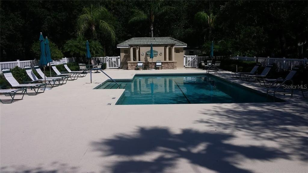 Sit in the sun or in the shade.  Take naps, swim laps, wear wraps...Enjoy! - Villa for sale at 6953 Mystic Ln, Sarasota, FL 34243 - MLS Number is A4188738