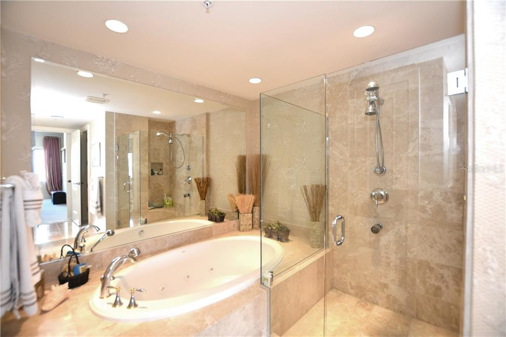 Relax and enjoy the rich details of this master bathroom with soaking tub, separate shower and dual sinks with marble tile flooring. - Condo for sale at 1111 Ritz Carlton Dr #1505, Sarasota, FL 34236 - MLS Number is A4188921