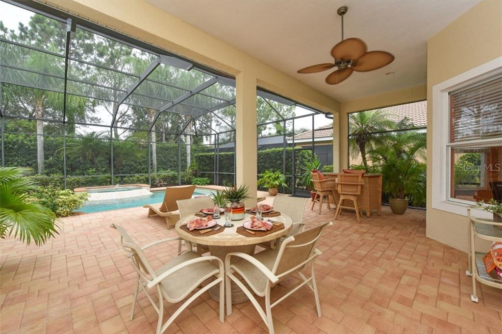 Single Family Home for sale at 7753 Us Open Loop, Lakewood Ranch, FL 34202 - MLS Number is A4188936