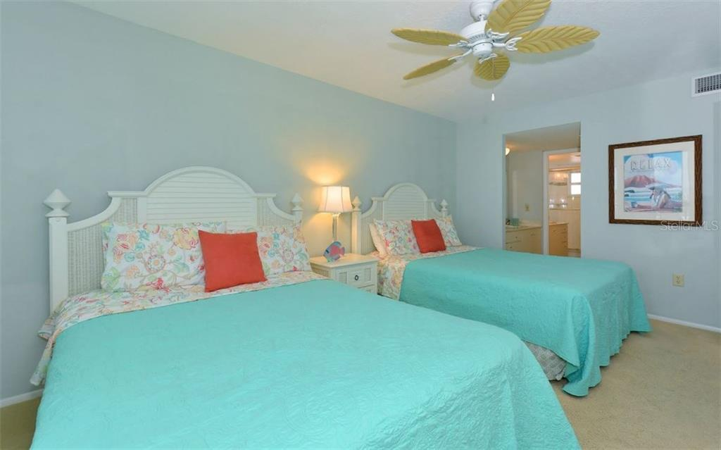 Master bedroom with en suite - Condo for sale at 6300 Midnight Pass Rd #806, Sarasota, FL 34242 - MLS Number is A4189340