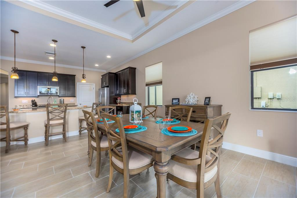 Dining area to kitchen - Single Family Home for sale at 23883 Waverly Cir, Venice, FL 34293 - MLS Number is A4190222