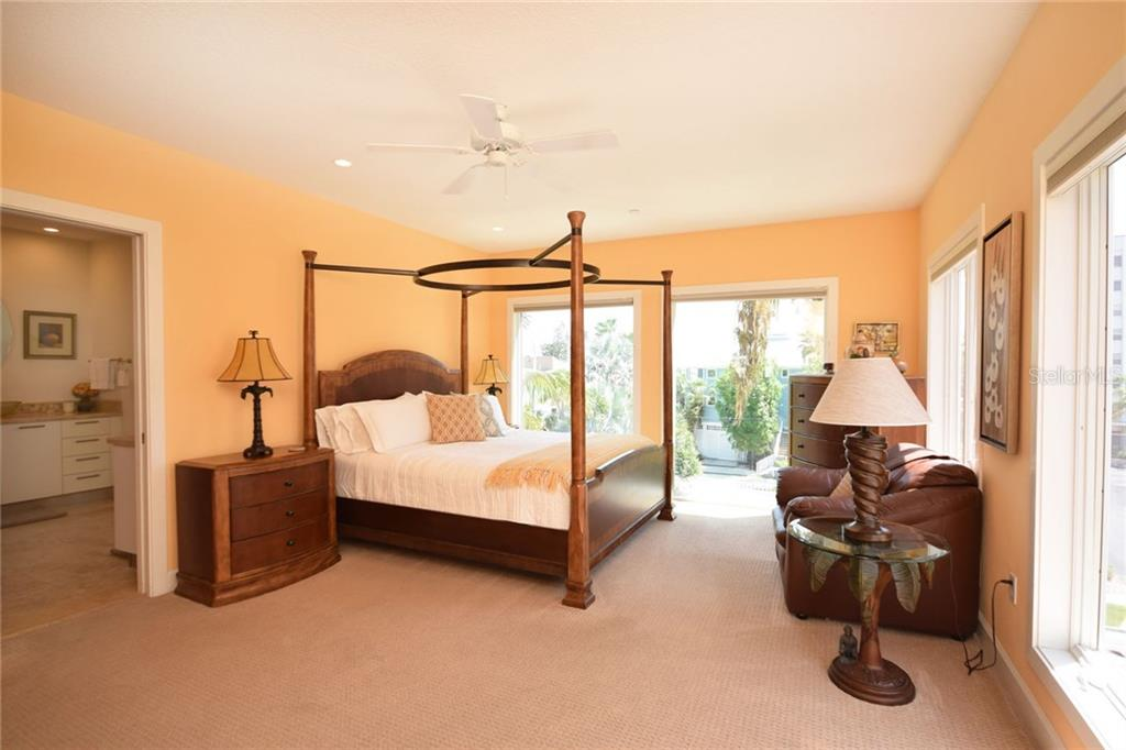 Master bedroom with fabulous master bath and well appointed walk in closet. - Condo for sale at 439 Beach Rd #e, Sarasota, FL 34242 - MLS Number is A4192797