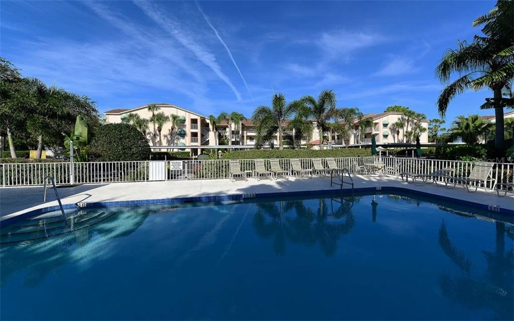 Clubside heated pool - steps away from this condo. - Condo for sale at 9300 Clubside Cir #1201, Sarasota, FL 34238 - MLS Number is A4192821