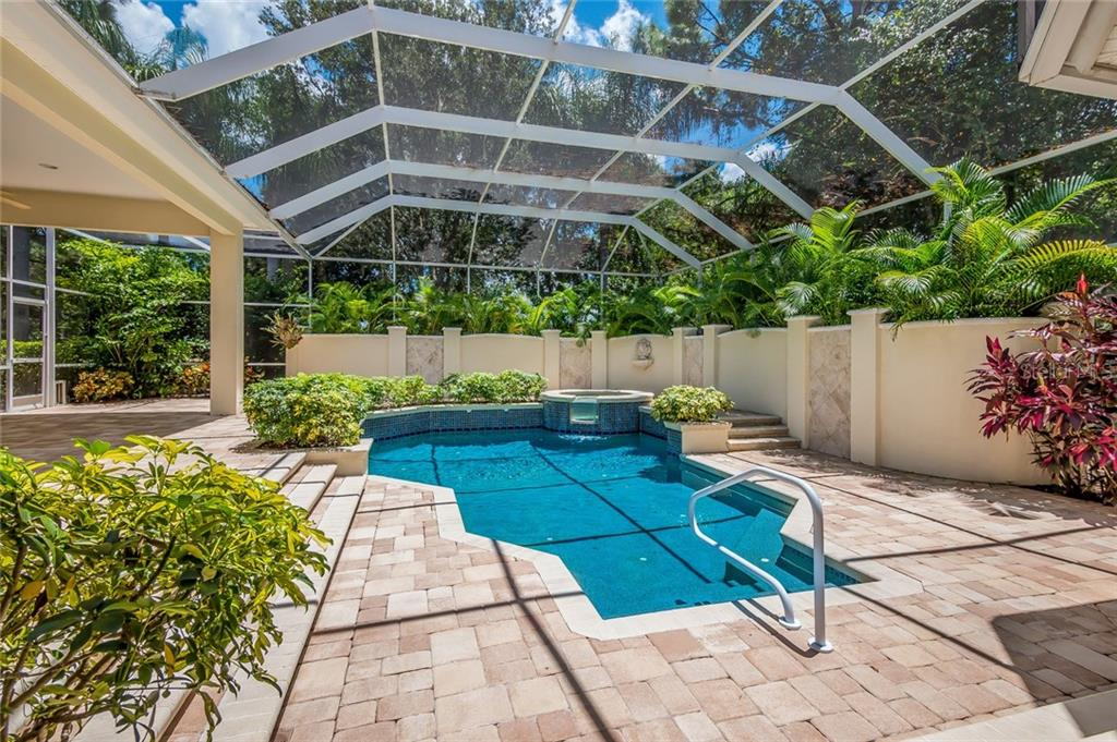 Beyond this privacy wall is a fenced backyard and a once butterfly garden. - Single Family Home for sale at 8019 Collingwood Ct, University Park, FL 34201 - MLS Number is A4193802