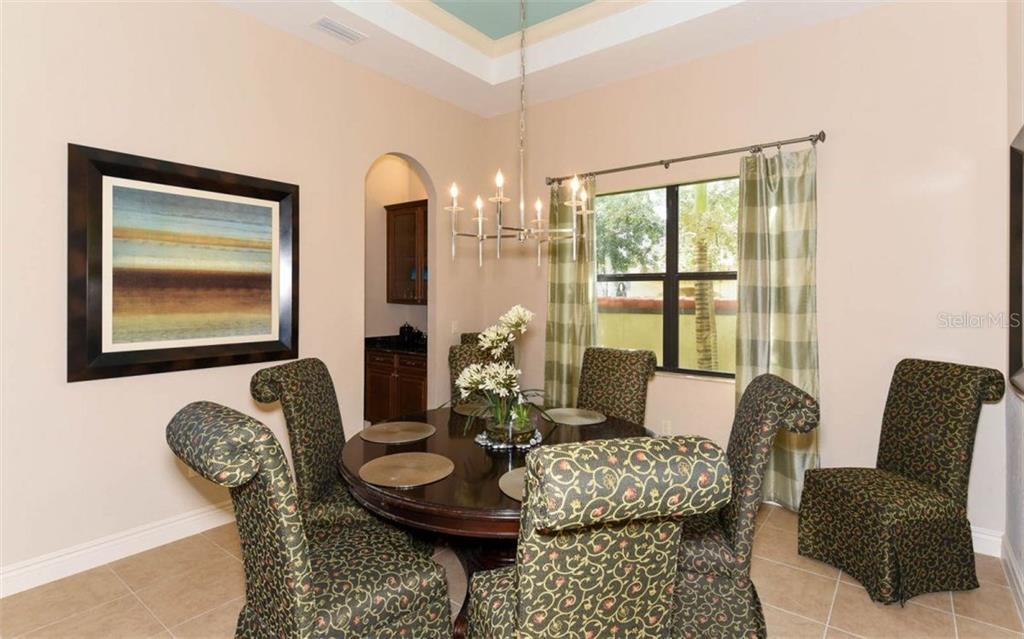Private dining room - Single Family Home for sale at 5605 Title Row Dr, Bradenton, FL 34210 - MLS Number is A4194268