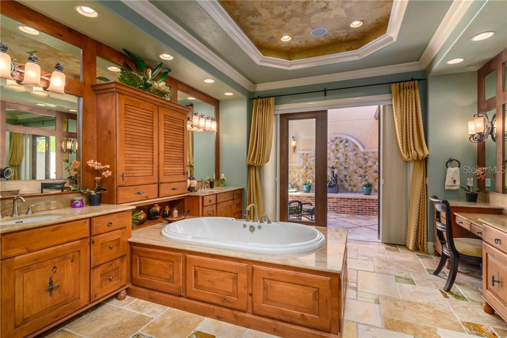 Stunning Master Bathroom with French Doors to a private Sunning Area - Single Family Home for sale at 11823 River Shores Trl, Parrish, FL 34219 - MLS Number is A4194999
