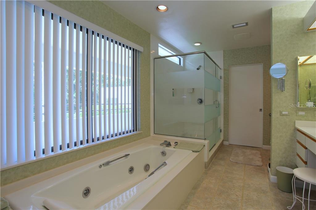 The owner's bathroom will invite you to relax and bubble your troubles away! - Single Family Home for sale at 4831 Hoyer Dr, Sarasota, FL 34241 - MLS Number is A4195351