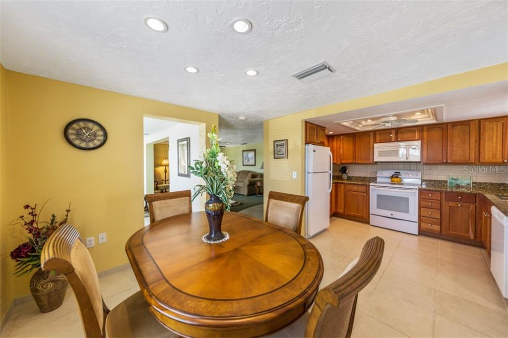 Dining area/Kitchen - Condo for sale at 6140 Midnight Pass Rd #c-9, Sarasota, FL 34242 - MLS Number is A4195879