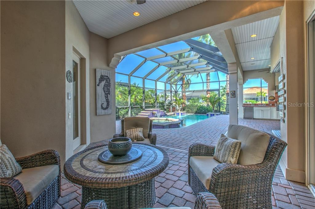Wonderful covered outside seating area, with triple open hurricane sliders brings the inside living area outside. - Single Family Home for sale at 548 Fore Dr, Bradenton, FL 34208 - MLS Number is A4196590