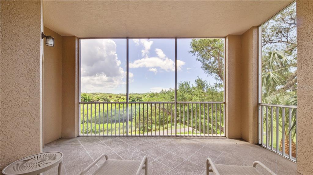 Lanai/ Living Room View - Condo for sale at 5531 Cannes Cir #306, Sarasota, FL 34231 - MLS Number is A4196722