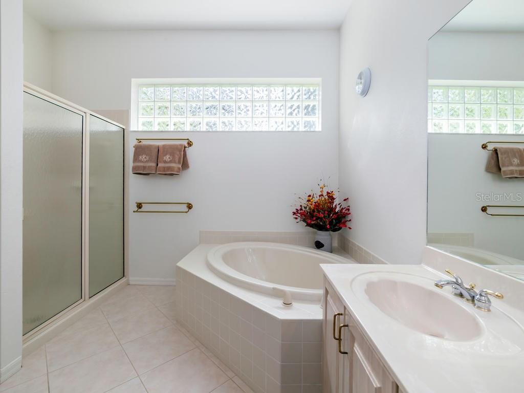 Master Bath with Walk In Shower - Villa for sale at 8773 Pebble Creek Ln, Sarasota, FL 34238 - MLS Number is A4197786