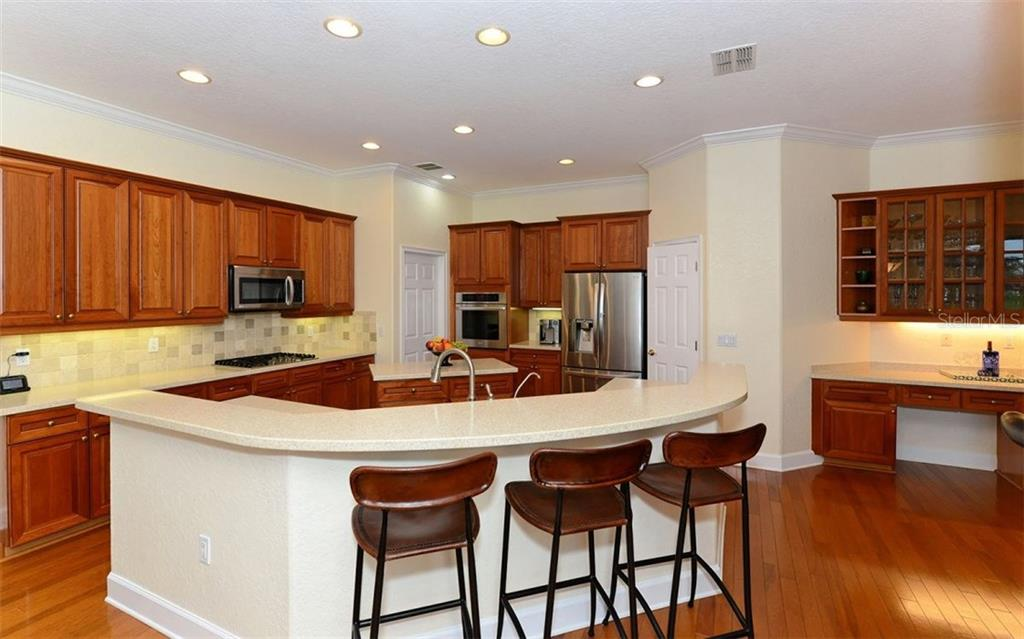 Kitchen - Single Family Home for sale at 9919 Portside Ter, Bradenton, FL 34212 - MLS Number is A4197815