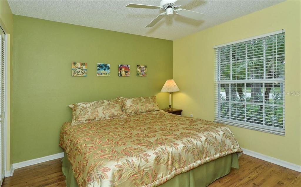 Guest bedroom. - Single Family Home for sale at 9571 Knightsbridge Cir, Sarasota, FL 34238 - MLS Number is A4197972