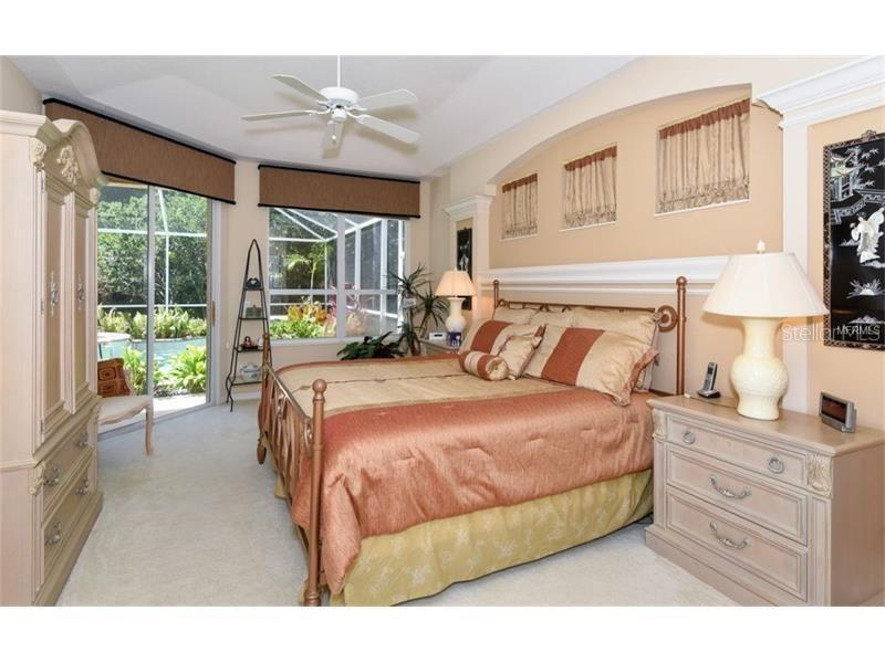 Master Bedroom Suite...Looking To The Pool! - Single Family Home for sale at 6910 Treymore Ct, Sarasota, FL 34243 - MLS Number is A4198957