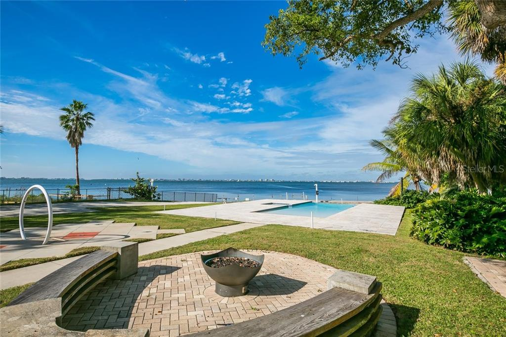 Fire pit with seating - Single Family Home for sale at 4035 Bay Shore Rd, Sarasota, FL 34234 - MLS Number is A4199264