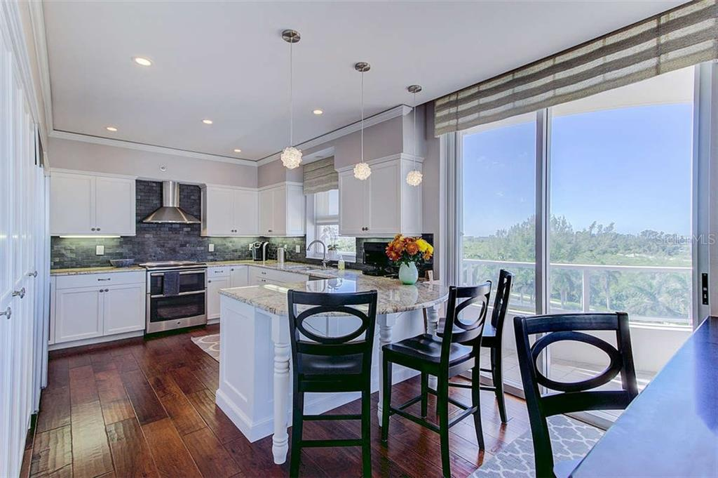 Kitchen w/Breakfast Bar - Condo for sale at 3060 Grand Bay Blvd #142, Longboat Key, FL 34228 - MLS Number is A4199568