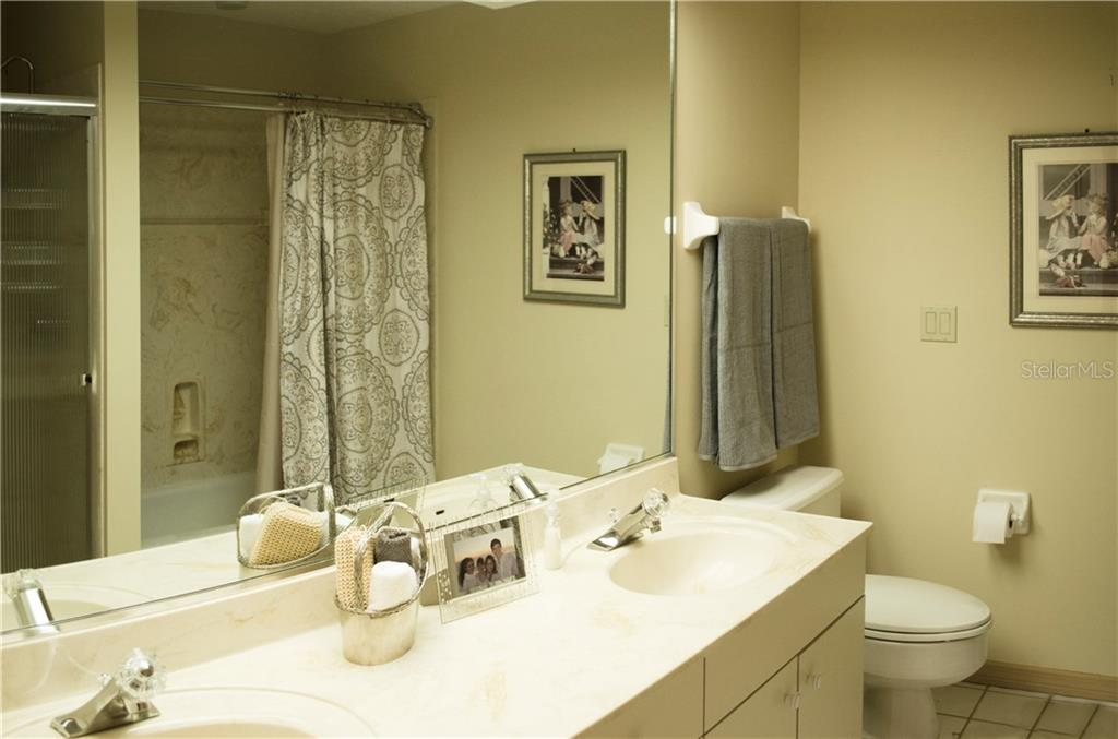 guest bathroom, has a tub and a separate shower and dual sinks - Single Family Home for sale at 7529 Weeping Willow Blvd, Sarasota, FL 34241 - MLS Number is A4201676