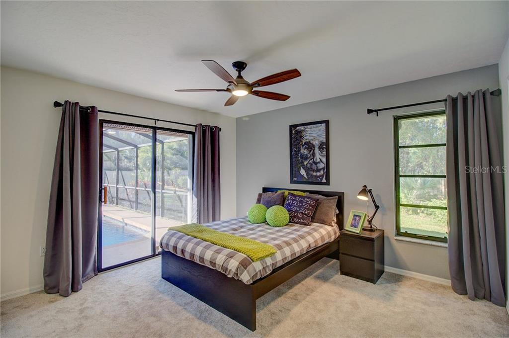 2nd Bedroom Overlooking Pool - Single Family Home for sale at 1087 Hoover Cir, Nokomis, FL 34275 - MLS Number is A4201722