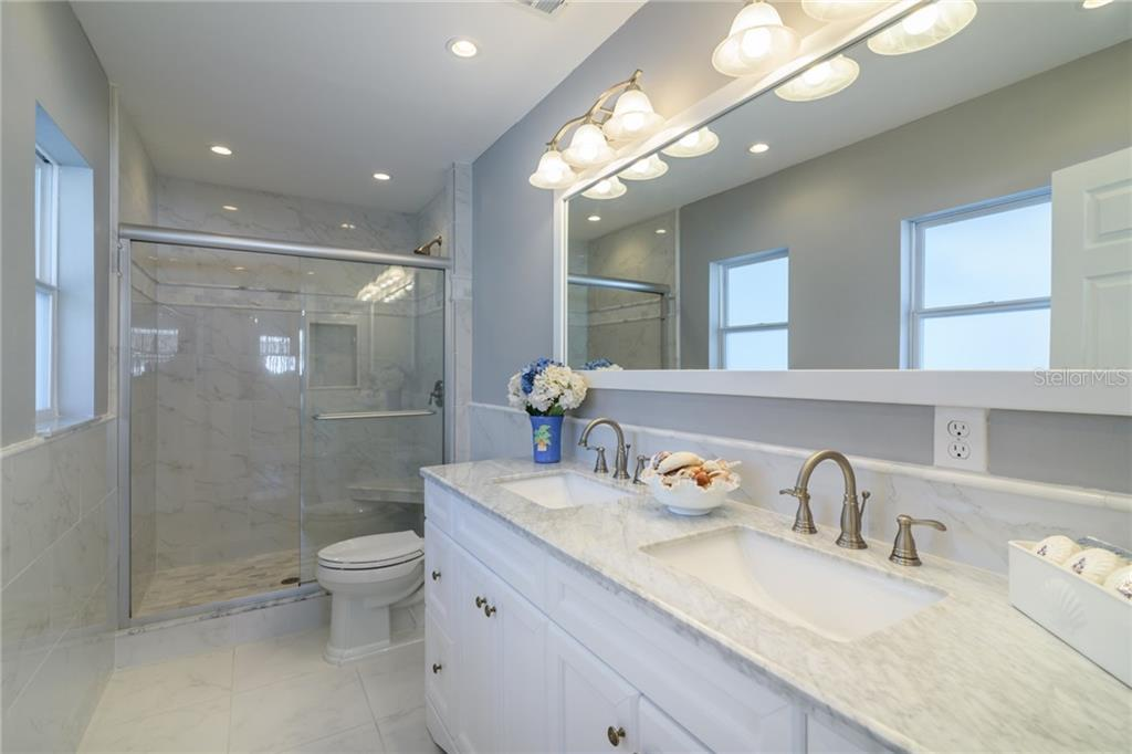 Master bathroom with double sink vanity and walk-in shower - Single Family Home for sale at 5439 Azure Way, Sarasota, FL 34242 - MLS Number is A4203969
