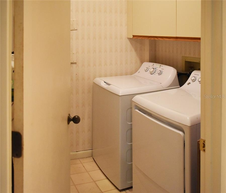 Inside Laundry Room. - Condo for sale at 1618 Starling Dr #105, Sarasota, FL 34231 - MLS Number is A4204864