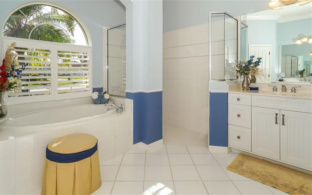 Large Master Bath with Roman Shower and large Soaking Tub - Single Family Home for sale at 460 Otter Creek Dr, Venice, FL 34292 - MLS Number is A4205372