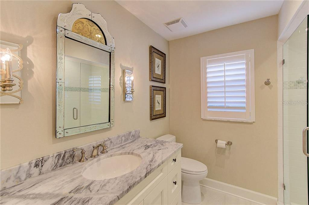Bathroom 2 with marble countertop, frameless shower. - Single Family Home for sale at 3508 Avenida Madera, Bradenton, FL 34210 - MLS Number is A4205393
