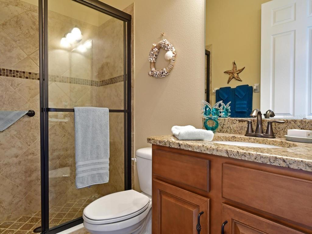 Guest bath with tiled, enclosed shower - Single Family Home for sale at 6601 Horned Owl Pl, Sarasota, FL 34241 - MLS Number is A4205612