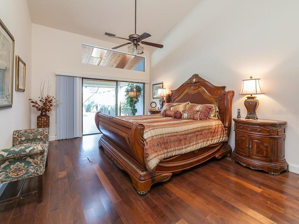 Master Bedroom, with sliding doors and transom window to pool and spa area - Single Family Home for sale at 3959 Prairie Dunes Dr, Sarasota, FL 34238 - MLS Number is A4205907