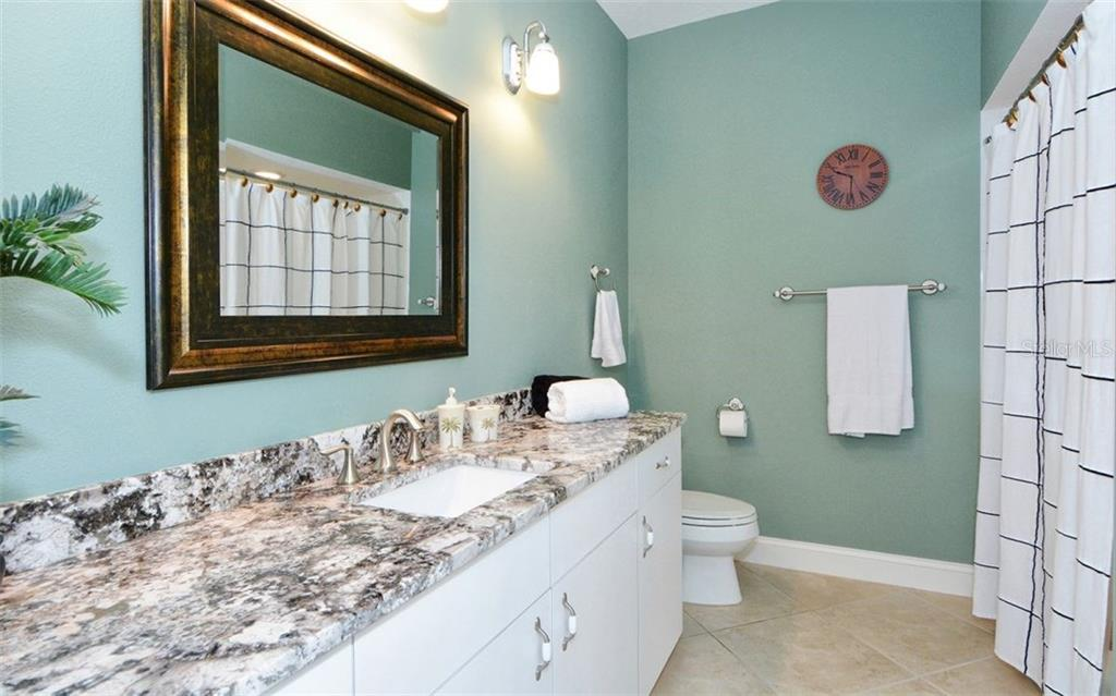 Full Bath for bedroom #2 & #3 - Single Family Home for sale at 3882 Spyglass Hill Rd, Sarasota, FL 34238 - MLS Number is A4206477