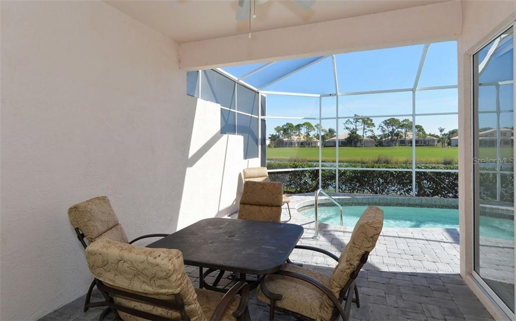 Covered lanai area opens to screened lanai and heated in-ground pool (resurfaced 2016.) - Villa for sale at 9554 Forest Hills Cir, Sarasota, FL 34238 - MLS Number is A4206506