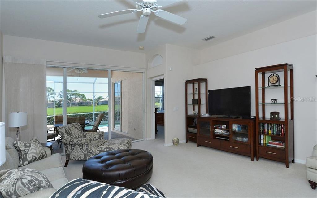 Master bedroom entrance on the right. - Villa for sale at 9554 Forest Hills Cir, Sarasota, FL 34238 - MLS Number is A4206506