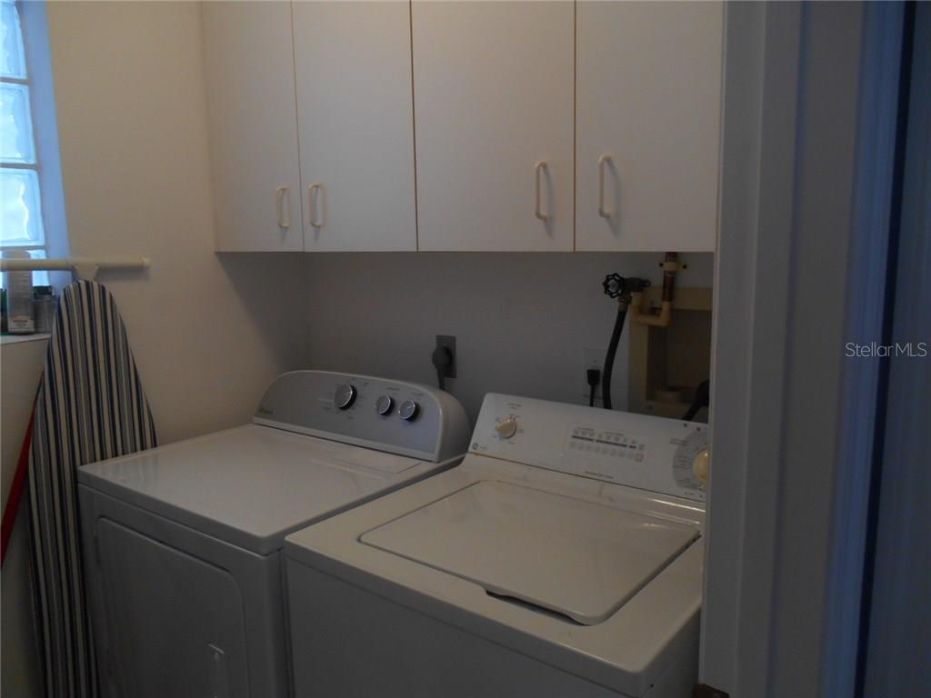 Indoor utility offers a full- sized washer and dryer and more cabinets! - Condo for sale at 815 Montrose Dr #202, Venice, FL 34293 - MLS Number is A4206556