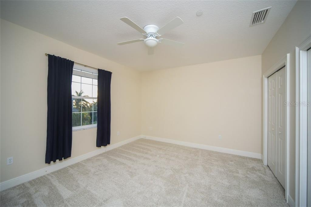 3rd Bedroom with brand new carpet - Single Family Home for sale at 7047 Hawks Harbor Cir, Bradenton, FL 34207 - MLS Number is A4206626