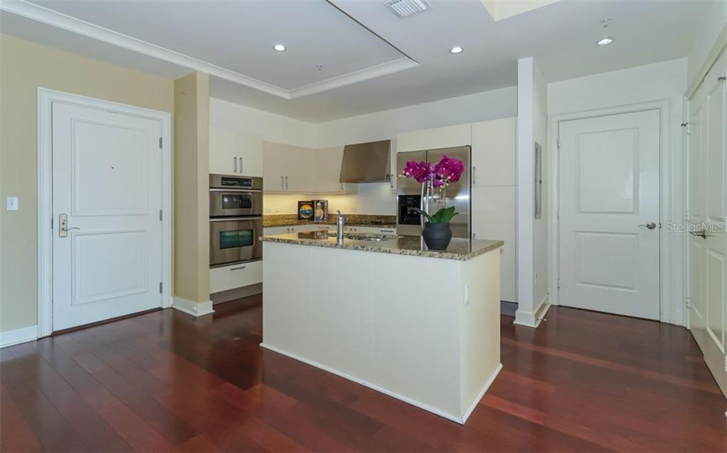 Wood flooring throughout - Condo for sale at 1350 Main St #608, Sarasota, FL 34236 - MLS Number is A4206707